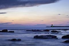 Coucher du soleil sur le phare Images stock