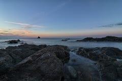 Coucher du soleil sur les roches Photographie stock