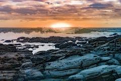 Coucher du soleil sur les roches Photo libre de droits