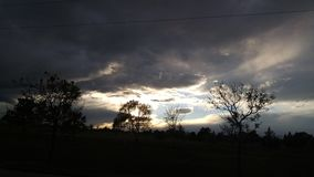 couchers du soleil foncés Photographie stock libre de droits