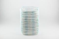 Couches-culottes de bébé sur un fond blanc Photo stock