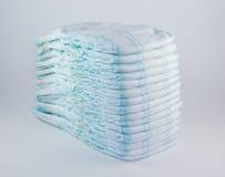 Couches-culottes de bébé sur un fond blanc Image stock