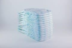Couches-culottes de bébé sur un fond blanc Photos libres de droits