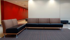 Couches in office. Couches arranged in a modern office Royalty Free Stock Images