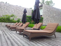 Couches at pool for sunbathe. Couches at poolside of hotel in thailand Royalty Free Stock Photos