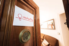 Couchsurfing Sign. Welcoming couchsurfing sign in a warm house stock photography