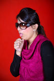 Cough. Girl coughing agianst the red background Royalty Free Stock Image