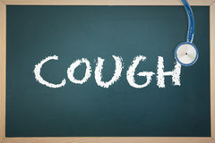 A Cough against chalkboard Stock Photo