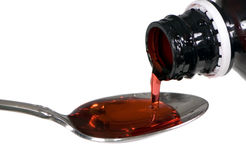 Cough Medicine. Pouring some cough medicine into a spoon Stock Image