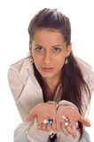 Cough medicine. Young woman holding pills for protection her cough stock photography