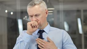 Cough, Portrait of Sick Grey Hair Businessman Coughing at Work. 4k high quality stock video