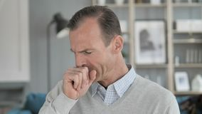Cough, Portrait of Sick Middle Aged Man Coughing at Work. 4k high quality, 4k high quality stock video footage