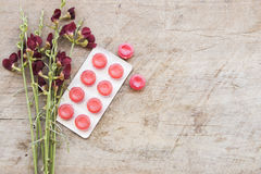 Cough sore throat pastille colorful and flowerw on table Stock Photo
