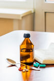 Cough Syrup Bottle With Spoon Close tothe Window Royalty Free Stock Image