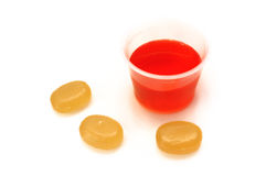 Cough Syrup and Throat Lozenges Stock Photos