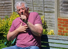 Coughing, colds, influenza or smokers cough.close up Stock Images