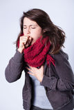 Coughing girl in scarf. Having high fever Stock Image