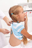 Coughing little girl at the doctor Stock Photography