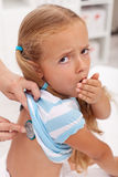 Coughing little girl at the doctors Royalty Free Stock Photos