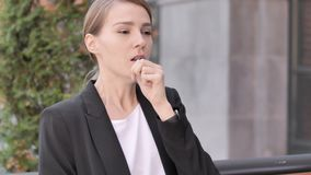 Coughing Sick Young Businesswoman Sitting Outdoor. 4k high quality, 4k high quality stock video
