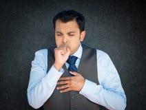 Coughing, sneezing sick man stock photos
