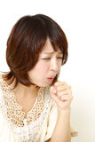 Coughing woman Stock Images