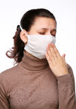 Coughing woman in a medical mask. On a white background Royalty Free Stock Image