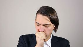 Coughing young man stock video