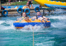 Couiple on water attractions during summer Stock Photos