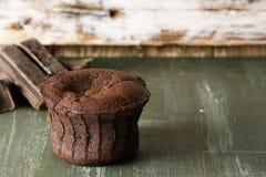 Coulant chocolate cake, baked on blue wood Royalty Free Stock Photo