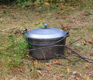 A couldron on the ground. Stock Images
