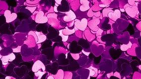 Couleur changeante de confettis en forme de coeur pourpres banque de vidéos