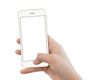 Couleur d'or de téléphone d'utilisation de main de plan rapproché d'isolement sur le fond blanc Photographie stock libre de droits