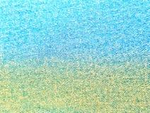 Couleur jaune et bleue de gradient, fond de jeans photographie stock