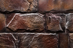 Couleur naturelle de mur en pierre de fond rouge-brun de texture Photos stock