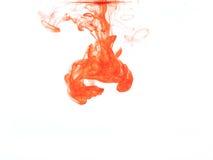 Couleur orange dans l'eau Images stock