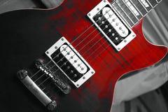 Couleur partielle d'une guitare rouge photographie stock