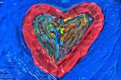 Couleurs peintes mélangées en forme de coeur photos libres de droits