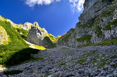 Couloir in mountains. Steep gully with a lot of small stones in Polish Tatra mountains royalty free stock images