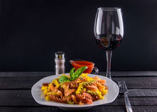 Coulourful pasta with wine stock images