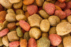 Coulourfull Dog Food Grains. Brown red green and orange dog food grains close up Royalty Free Stock Image