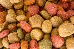 Coulourfull-Hundefutter-Körner lizenzfreies stockbild