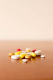 Coulourfull Pills Medicine. Laying on the table red white yellow and orange pills Stock Photography