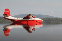Coulson Flying Tankers. FRASER LAKE, BC- AUG 23 2010-Martin Mars (Coulson) flying water tanker sits in Fraser Lake, BC. The huge amphibian fire fighting plane is Royalty Free Stock Images