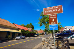 Coulterville Sign in California`s Sierra Nevada. Coulterville, California - July 27, 2014: A sign marking downtown Coulterville, a gold mining town about 30 Stock Photo