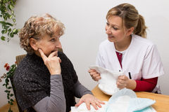 Counceling interview. Nurse giving an retiree some advice Stock Photography