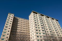 A council apartment block against a clear blue sky. Occupied predominantly by welfare recipients, immigrants and the elderly. A typical Australian housing stock image