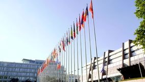 Council of Europe with UK and France flag half-mast stock video footage