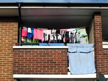 Council flat balcony. Washing hanging on a line on a balcony of a typical council flat in the heart of a deprived area of  London, England Royalty Free Stock Photo