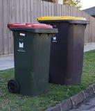 Council municipal bins on street curb stock image